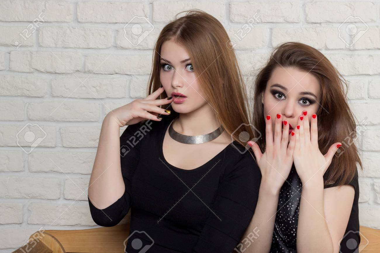 Admirable Two Beautiful Young Girls In Black Dresses Sit On The Bench And Pabps2019 Chair Design Images Pabps2019Com