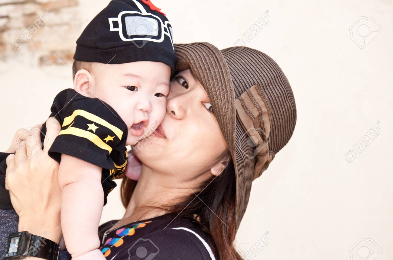 mother's love - cute baby 4 months boy with mother Stock Photo - 10967657