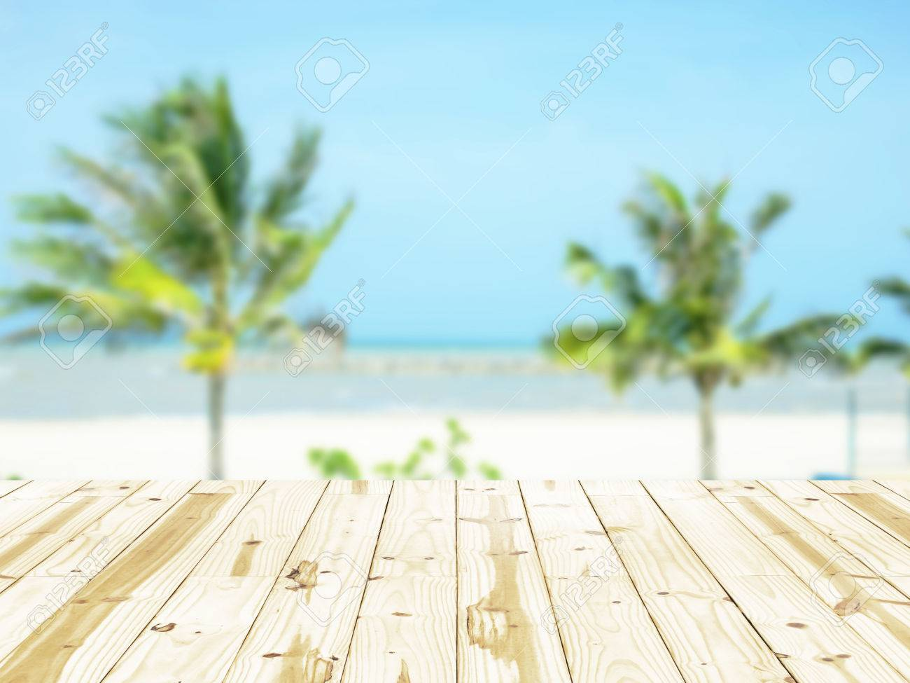 wood table top on sea beach blurry backgrounds. stock photo, picture