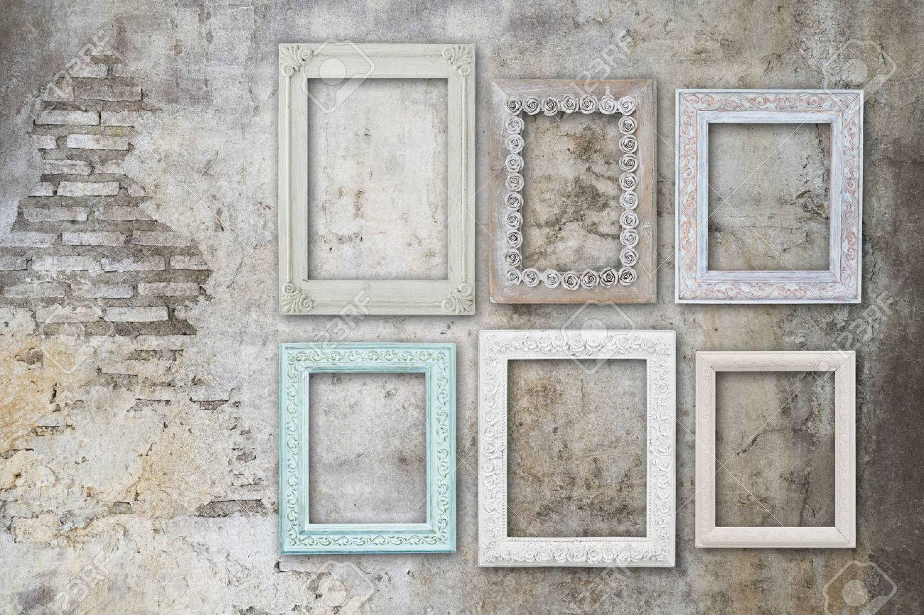 Vintage Old Wooden Frames On Concrete Grungy Wall Stock Photo ...