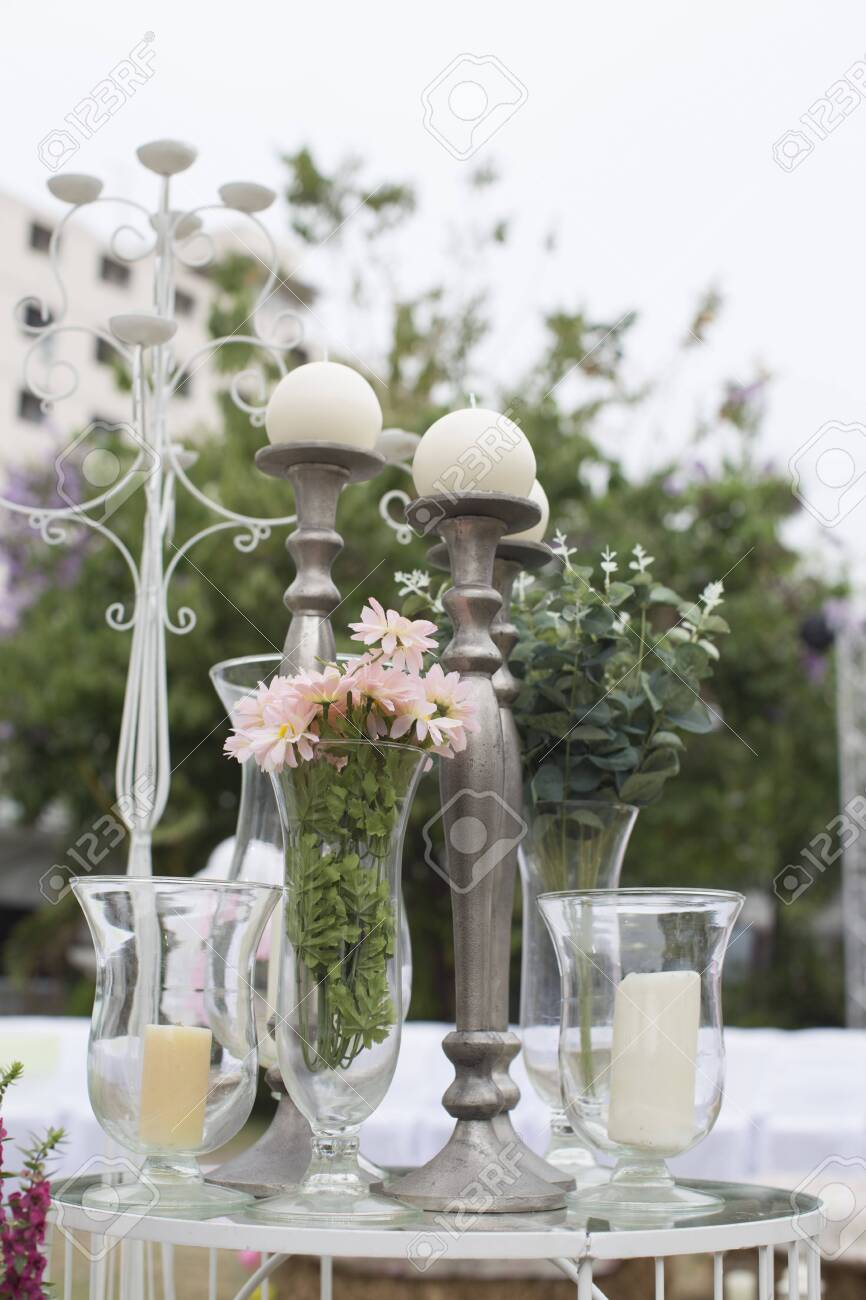 Outdoor catering dinner at the wedding with homemade garnishes decoration - 148336721