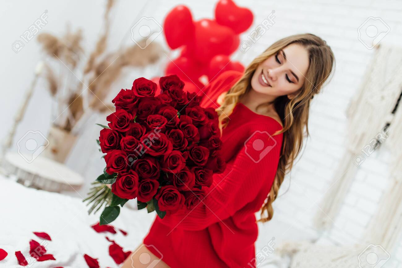 Blonde Young Woman Holding Big Bouquet Of Red Roses With Heart Stock Photo Picture And Royalty Free Image Image 140359105