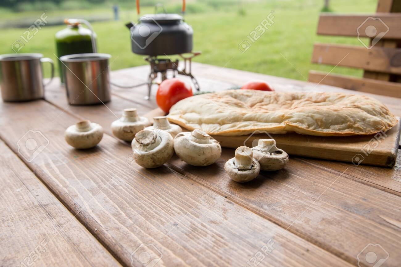 fresh mushrooms and fragrant pita on the table - 148970978