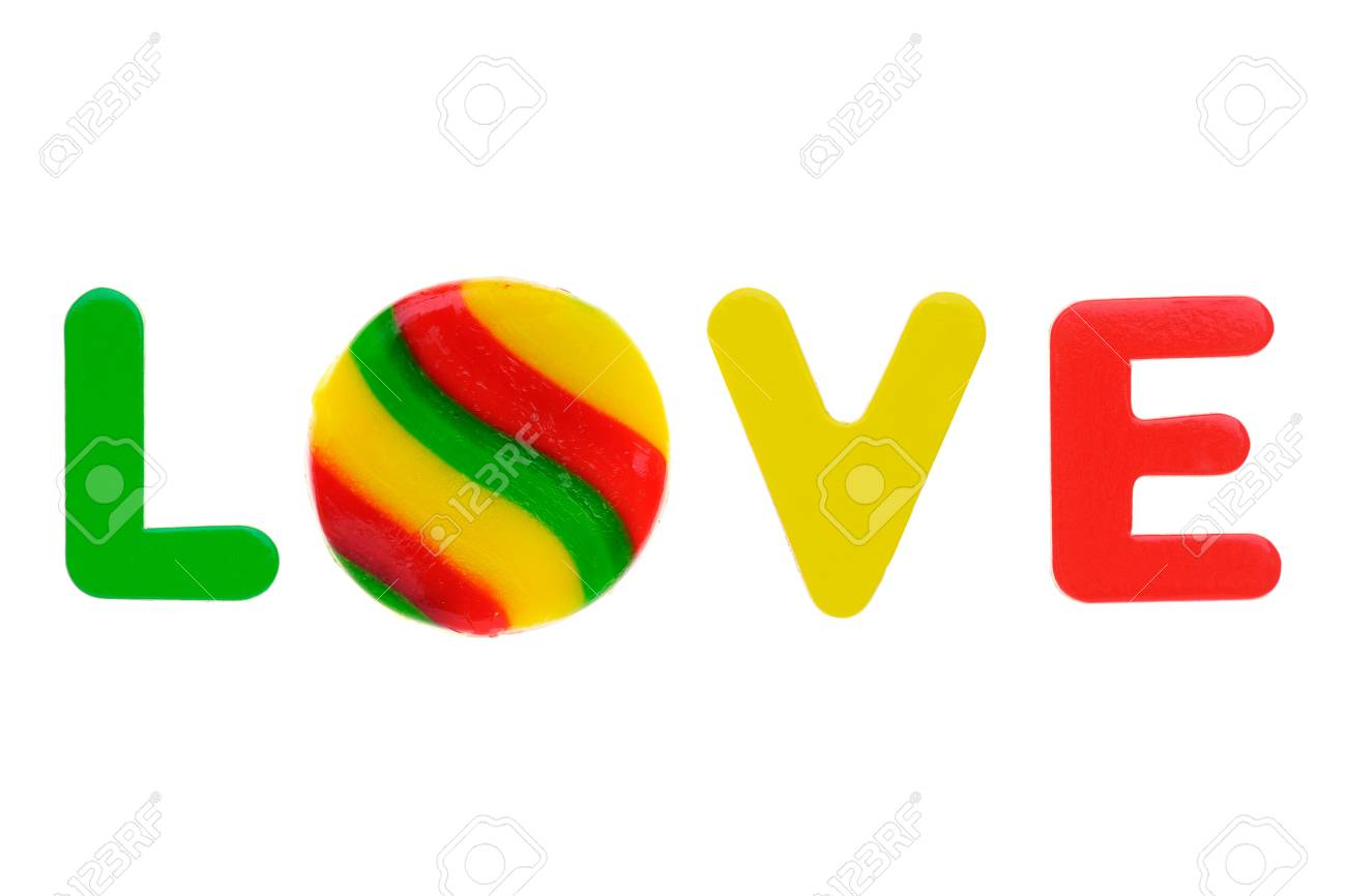 Love, written with magnetic learning letters and sweet lollipop isolated on white background Stock Photo - 11703270