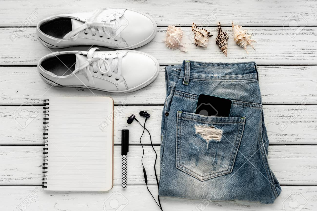 d573ac972de Stock Photo - Summer holiday concept  blue worn jeans with a smartphone in  the pocket