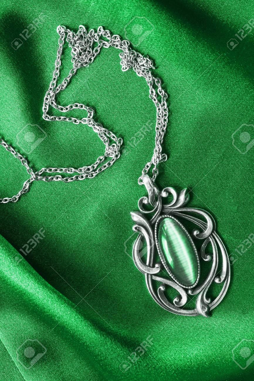 Silver emerald pendant on green draped satin stock photo picture silver emerald pendant on green draped satin stock photo 42063669 aloadofball Choice Image