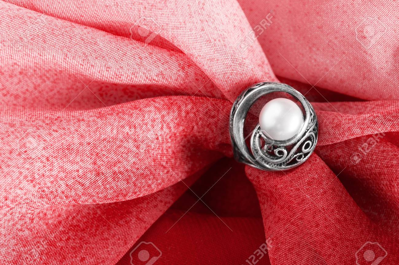 Vintage Pearl Ring On Draped Red Cloth As A Background Stock Photo ...
