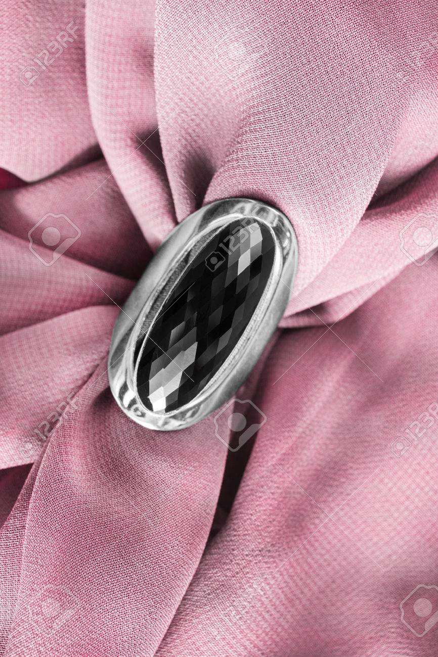Black Onyx Ring On Draped Pink Silk As A Background Stock Photo ...