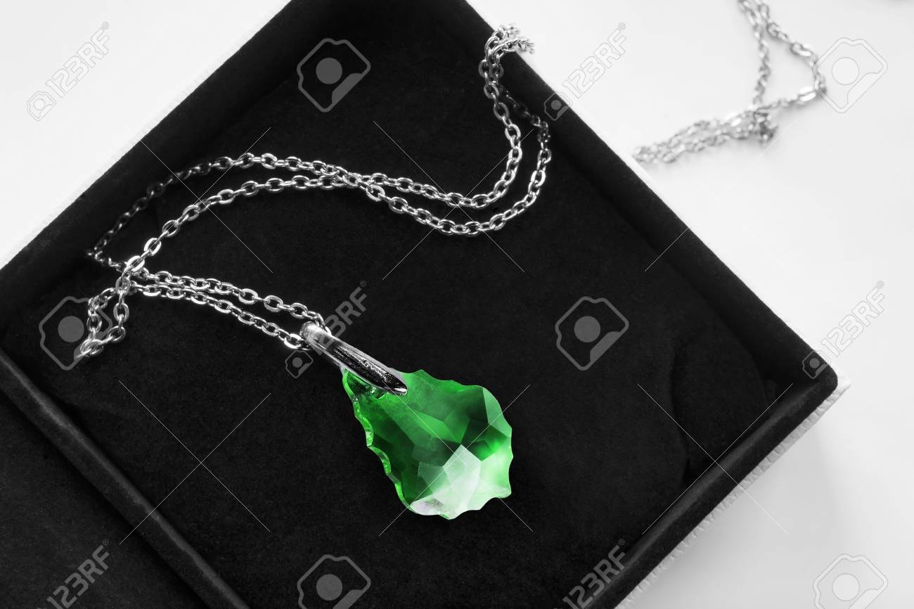 e003568d34 Large emerald pendant on a chain in black jewel box Stock Photo - 80130324
