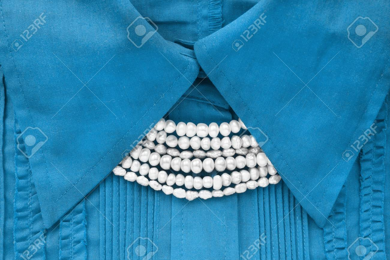 99ccbd26155d73 White pearl necklace on blue blouse closeup as a background Stock Photo -  81892332