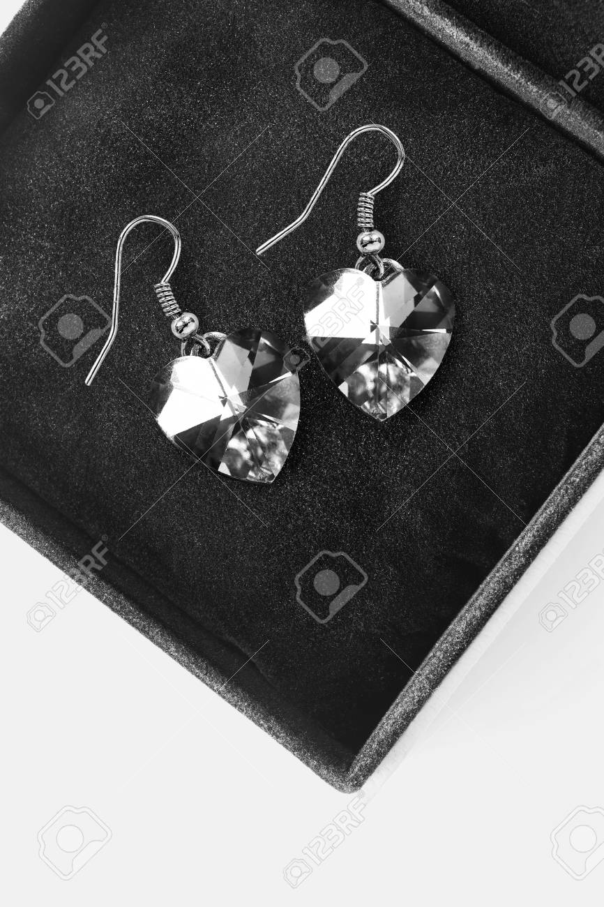 74aed9c76d561 Pair of crystal heart shaped earrings in black jewel box closeup Stock  Photo - 87637380