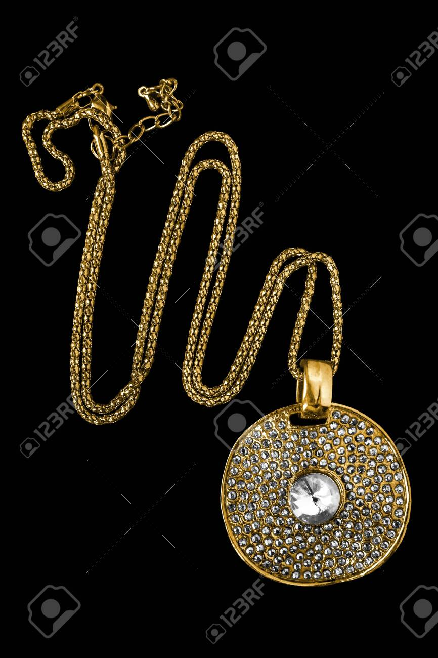 Vintage Large Gold Medallion With Crystals Isolated Over Black Stock Photo Picture And Royalty Free Image Image 129601802