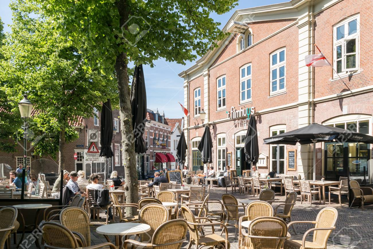 Outdoor Restaurant And Cafe Terraces On Groenmarkt Square In