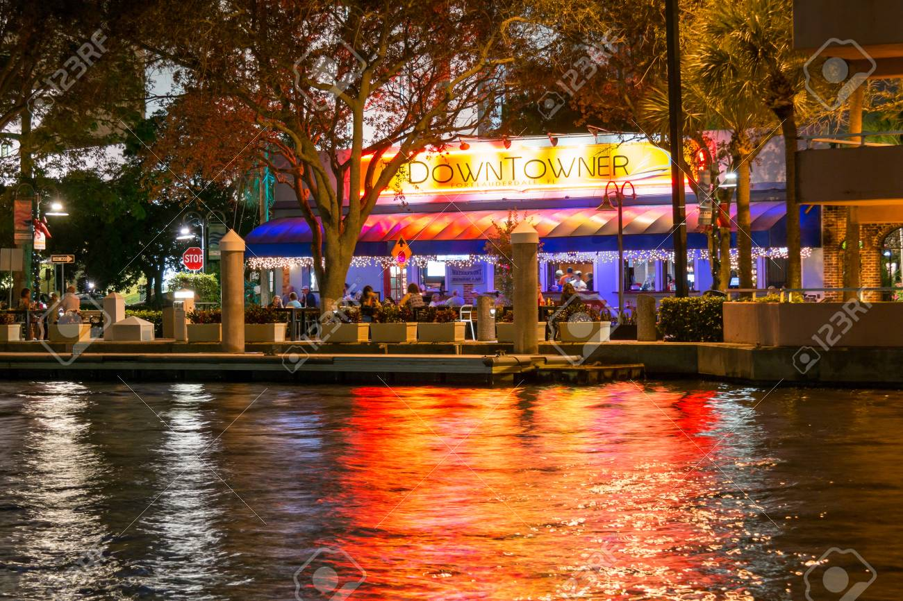 Night View Of Restaurant Downtowner Alongside New River In Downtown