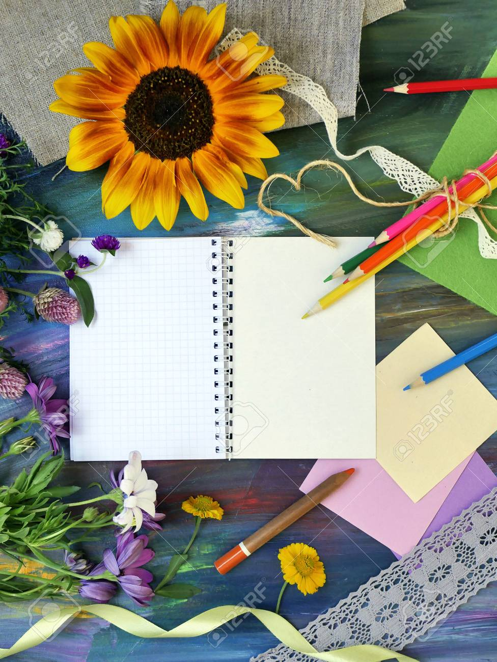 Bright Decorative Composition Of Art Materials Notepad And Flowers