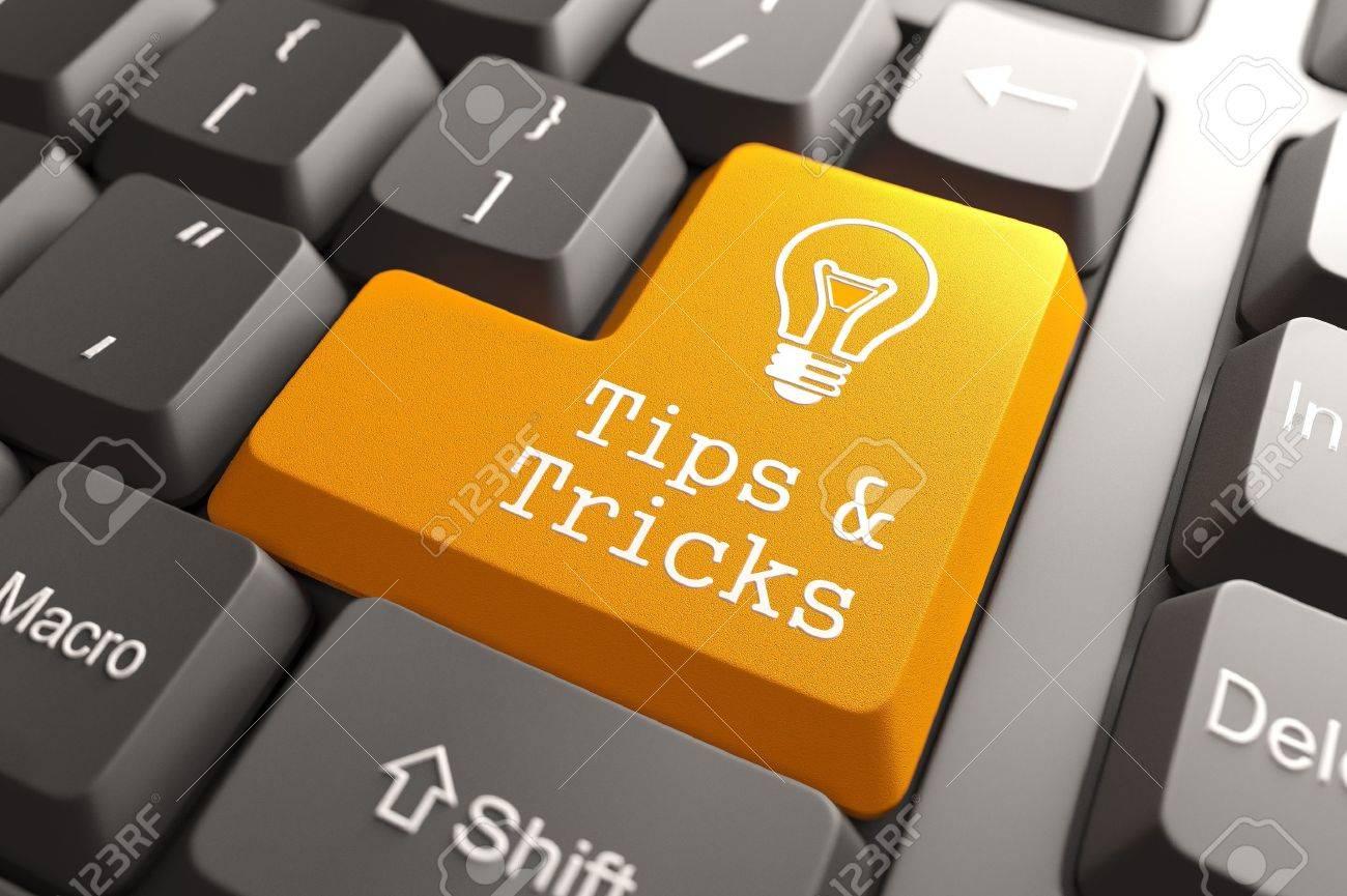 Orange Tips and Tricks Button on Computer Keyboard Internet