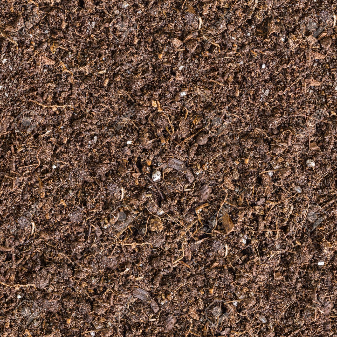 茶色の土のシームレスなタイルの...