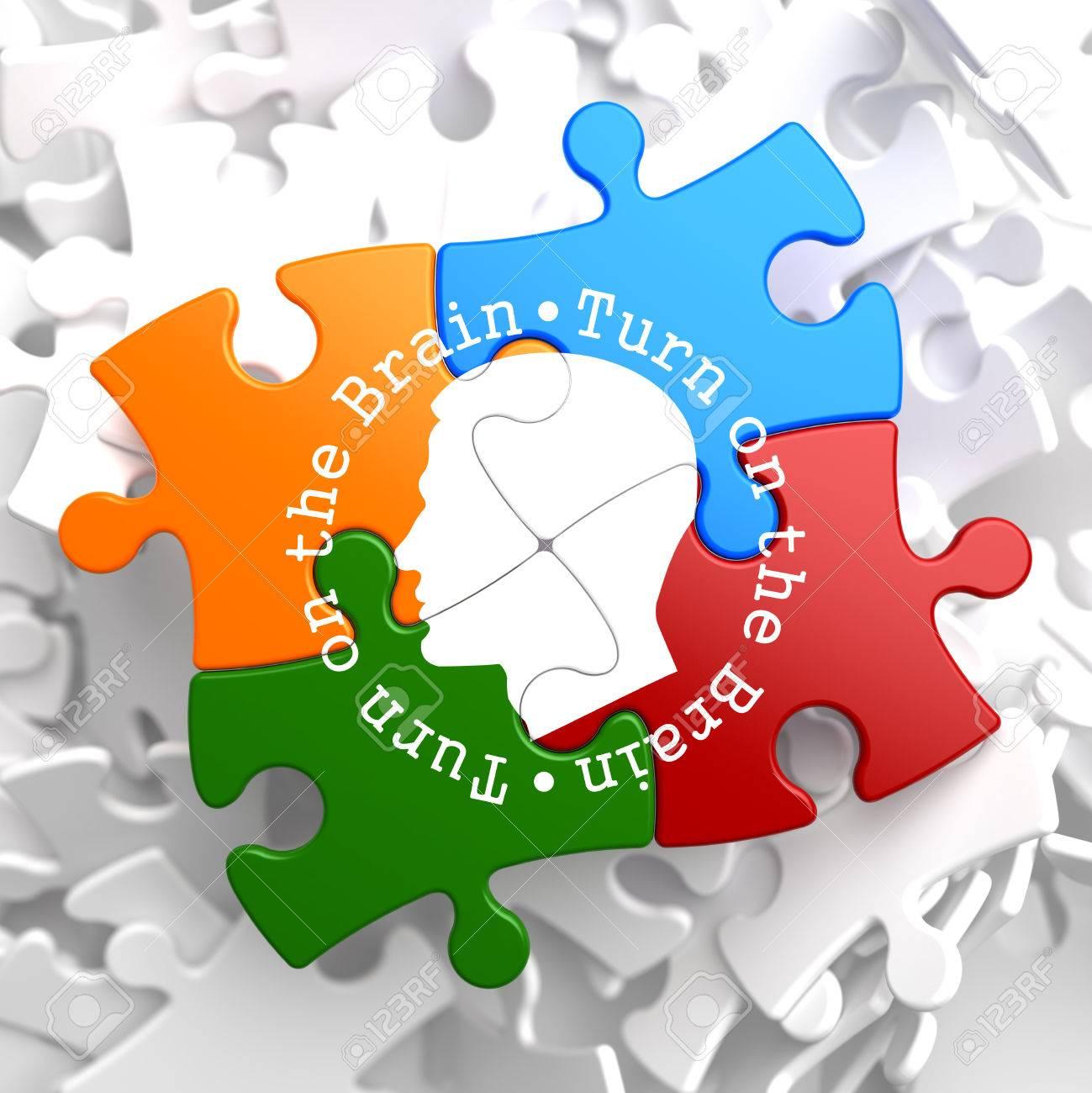 Turn On the Brain Written Arround Human Head Icon on Multicolor Puzzle. Stock Photo - 23101587