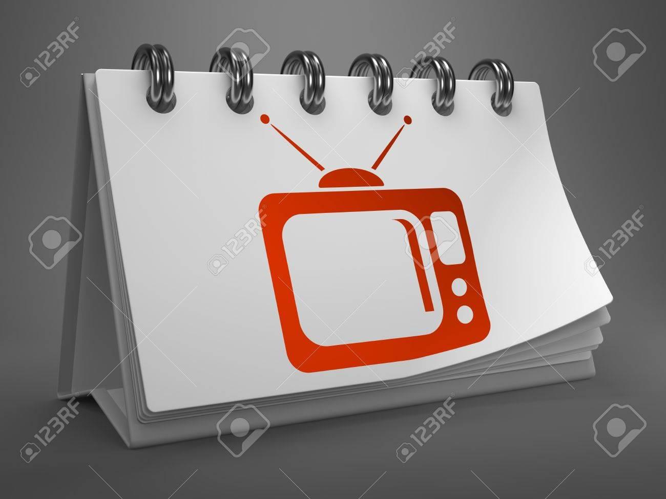 Rouge tv set icône sur le calendrier de bureau blanc isolé sur