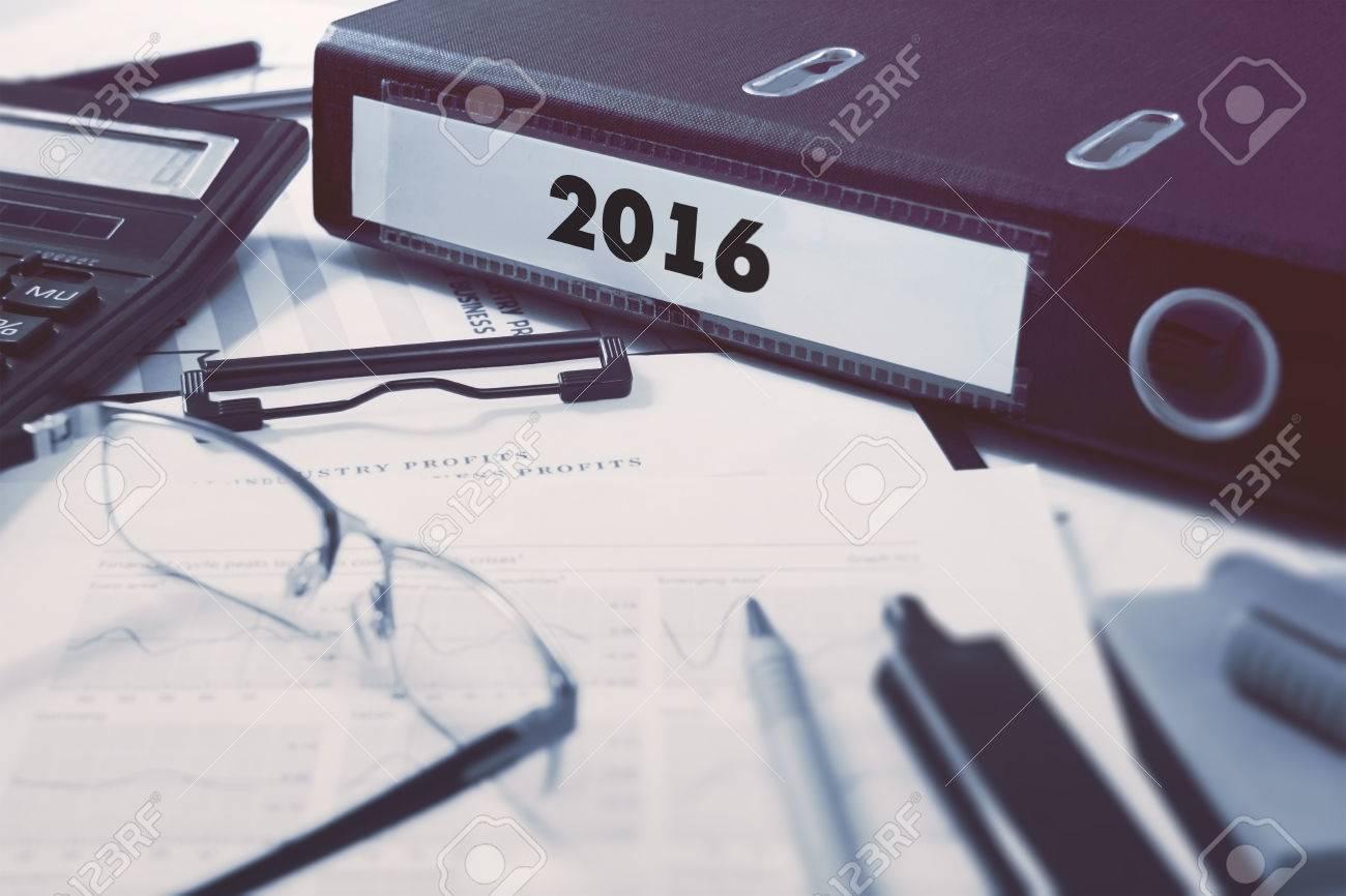 2016 - Ring Binder on Office Desktop with Office Supplies. Standard-Bild - 42868982