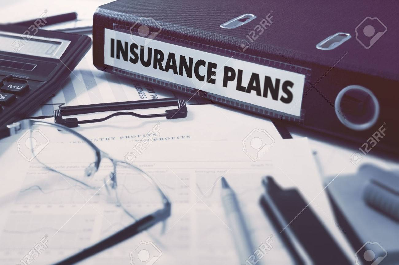 Insurance Plans - Ring Binder on Office Desktop with Office Supplies. Business Concept on Blurred Background. Toned Illustration. Standard-Bild - 44608475