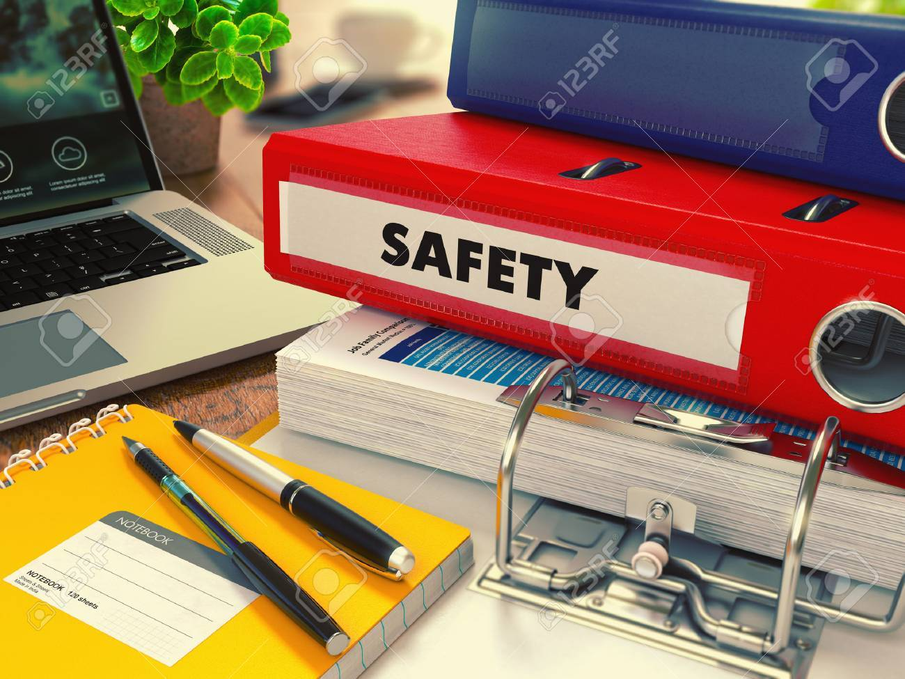 Red Office Folder with Inscription Safety on Office Desktop with Office Supplies and Modern Laptop. Business Concept on Blurred Background. Toned Image. Standard-Bild - 45649277