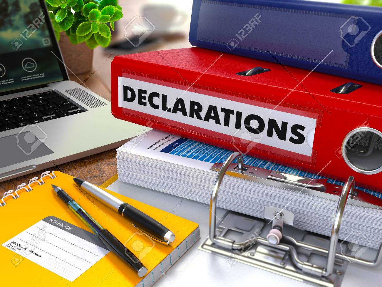 Red Ring Binder with Inscription Declarations on Background of Working Table with Office Supplies, Laptop, Reports. Toned Illustration. Business Concept on Blurred Background. Standard-Bild - 46812981