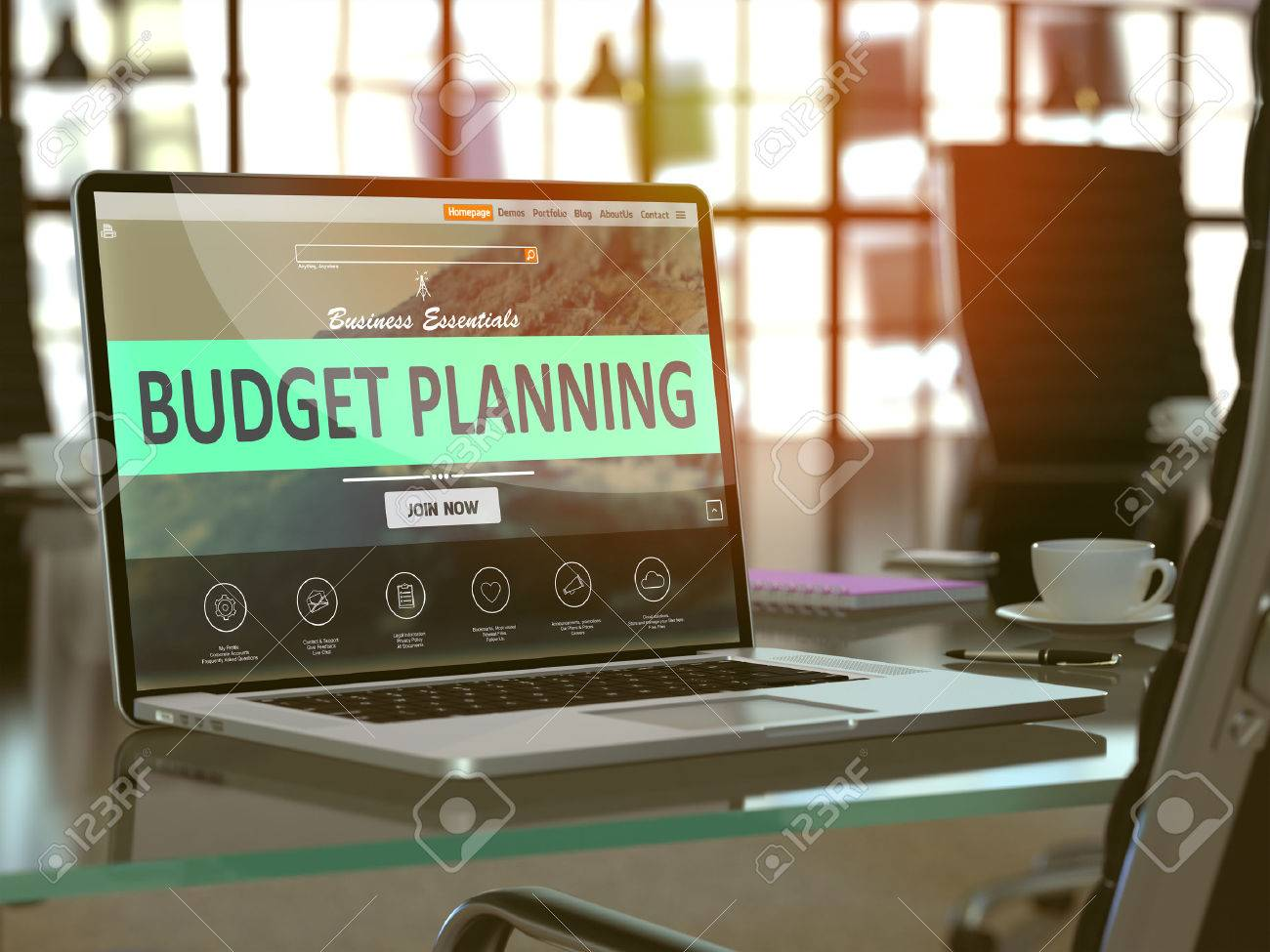 Modern Workplace with Laptop showing Landing Page with Budget Planning Concept. Toned Image with Selective Focus. - 50518196