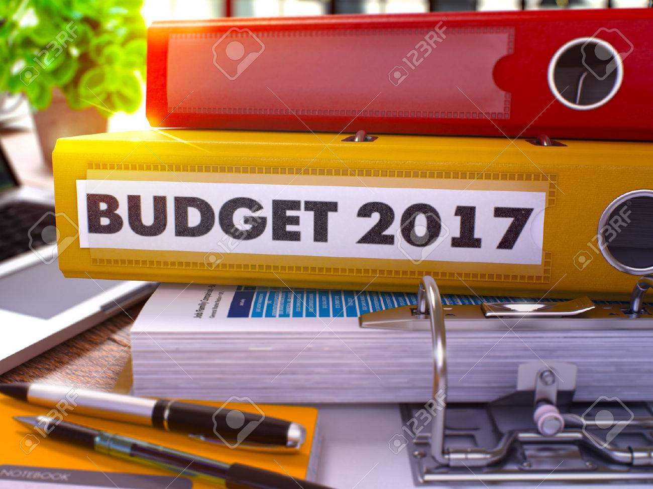 Yellow Office Folder with Inscription Budget 2017 on Office Desktop with Office Supplies and Modern Laptop. Budget 2017 Business Concept on Blurred Background. Budget 2017 - Toned Image. 3D Standard-Bild - 51830573