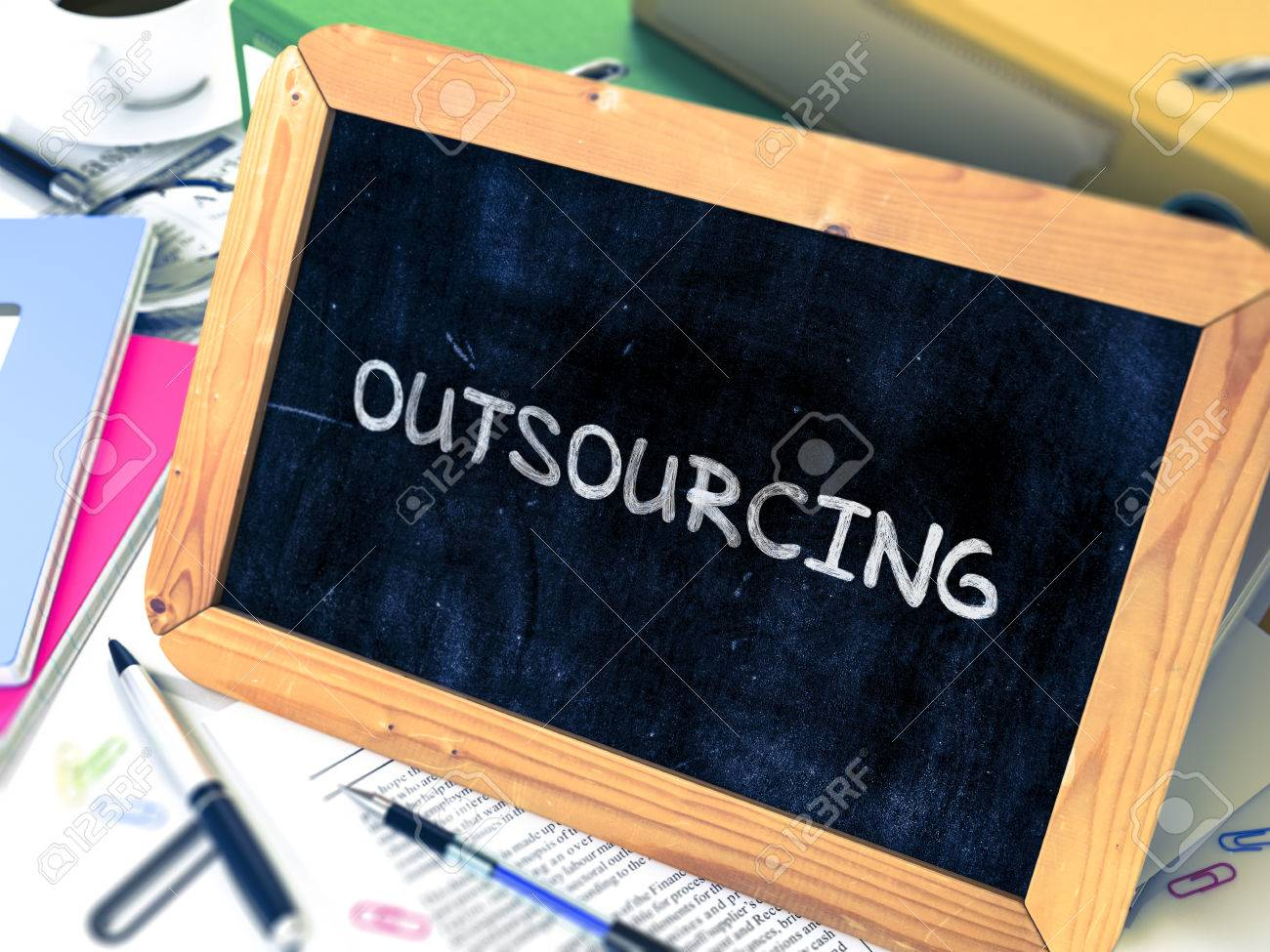outsourcing handwritten by chalk on a blackboard composition