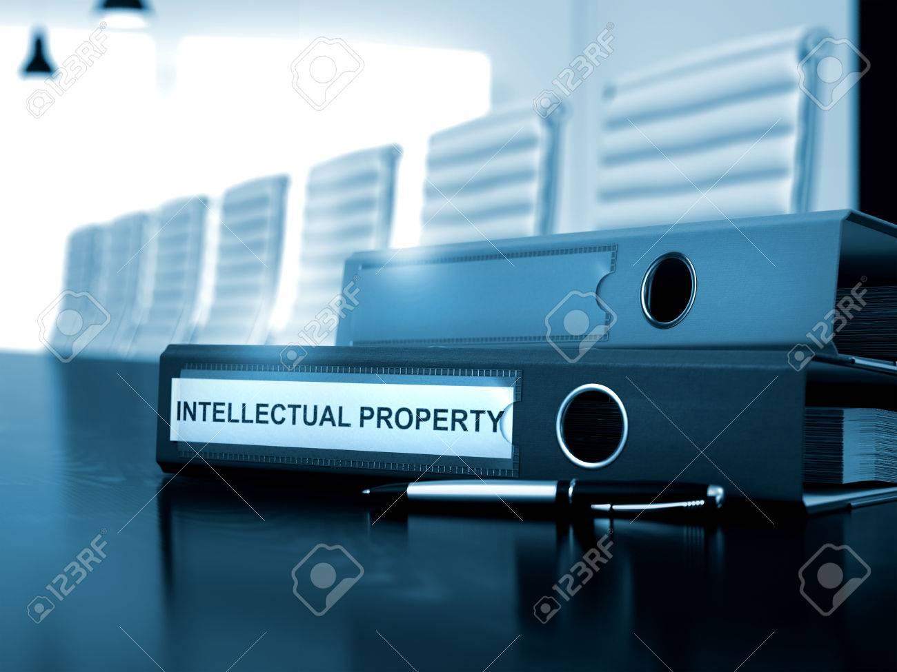 Office Binder with Inscription Intellectual Property on Office Desktop. Intellectual Property - Illustration. Toned Image. 3D Render. Standard-Bild - 54092078