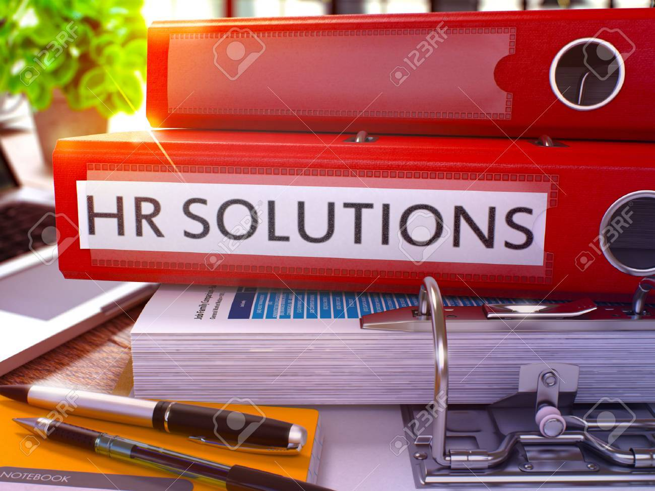 Red Ring Binder with Inscription HR - Human Resource - Solutions on Background of Working Table with Office Supplies and Laptop. HR Solutions Business Concept on Blurred Background. 3D Render. Standard-Bild - 54368311