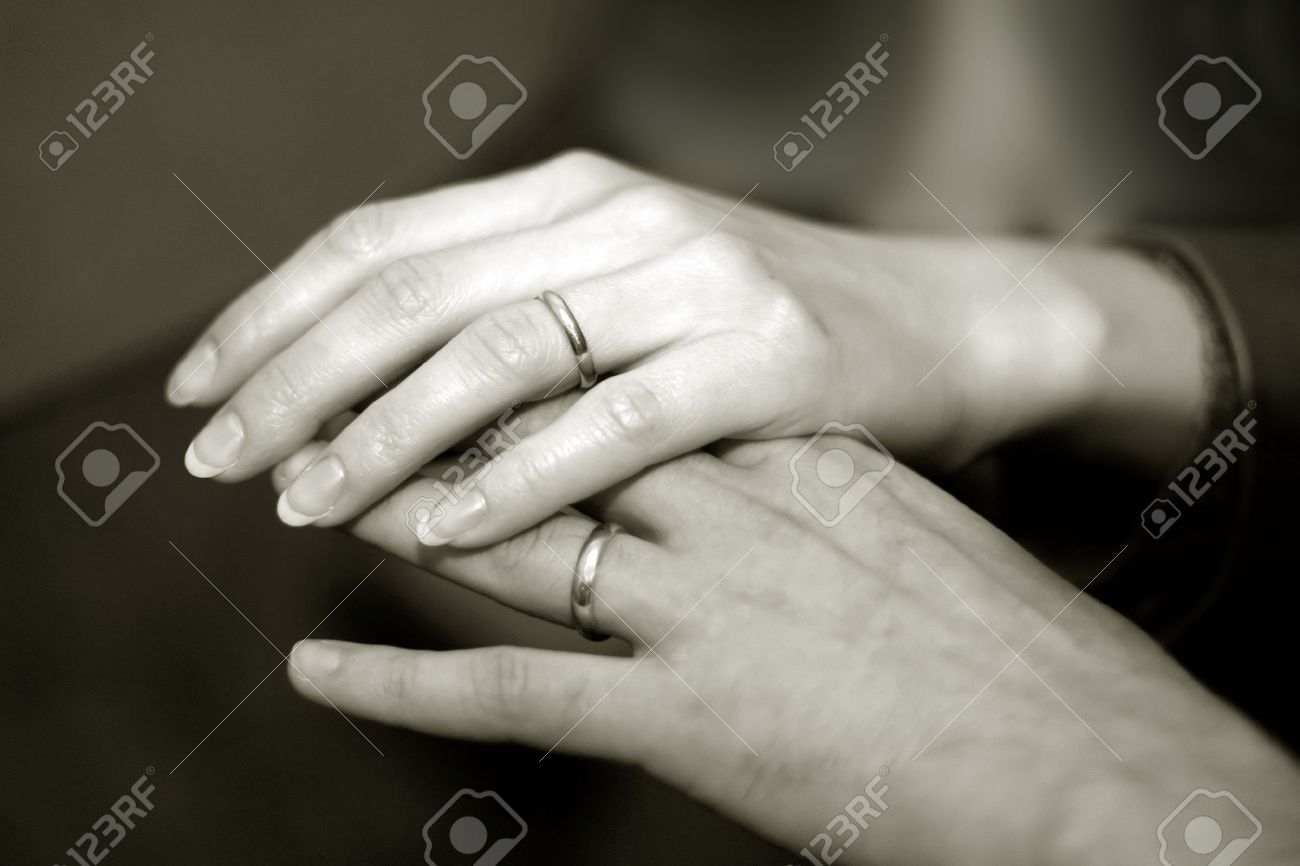 Just Married Couple Holding Hands With Wedding Rings Stock Photo