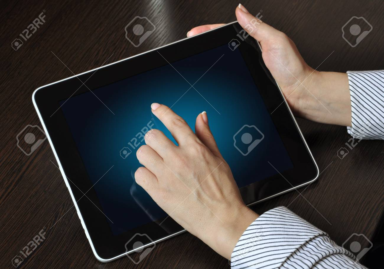 female hand touching screen on modern digital tablet pc. Stock Photo - 12929906