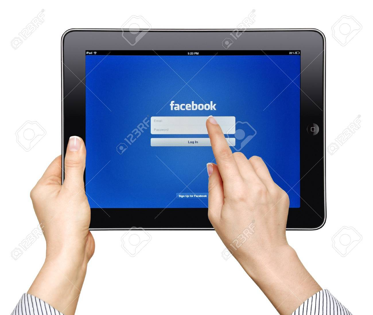 Apple iPad  with facebook app on screen in female hands  Editorial studio shot  Stock Photo - 13436652