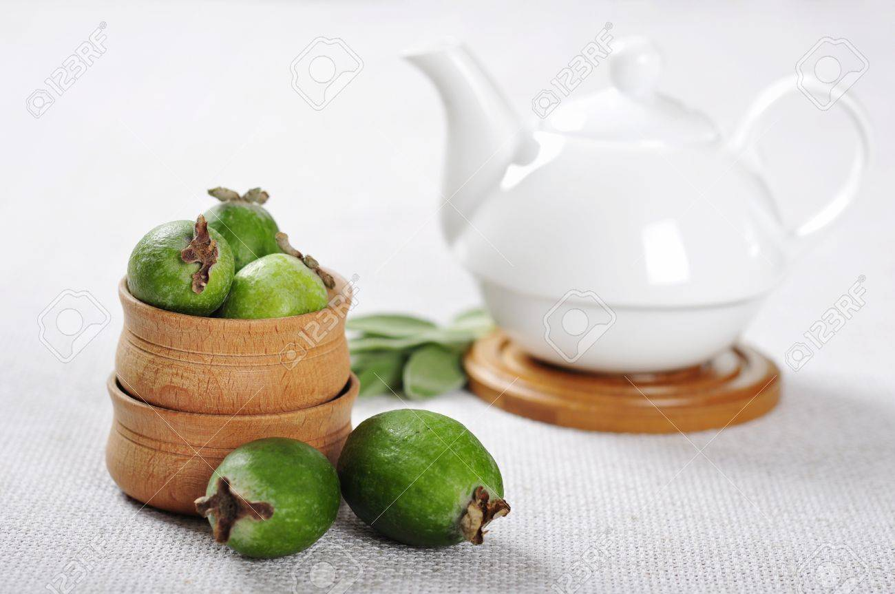 Stock Photo Fresh Ripe Pineapple Guava Fruit In Wooden Bowls On A Beige  Tablecloth