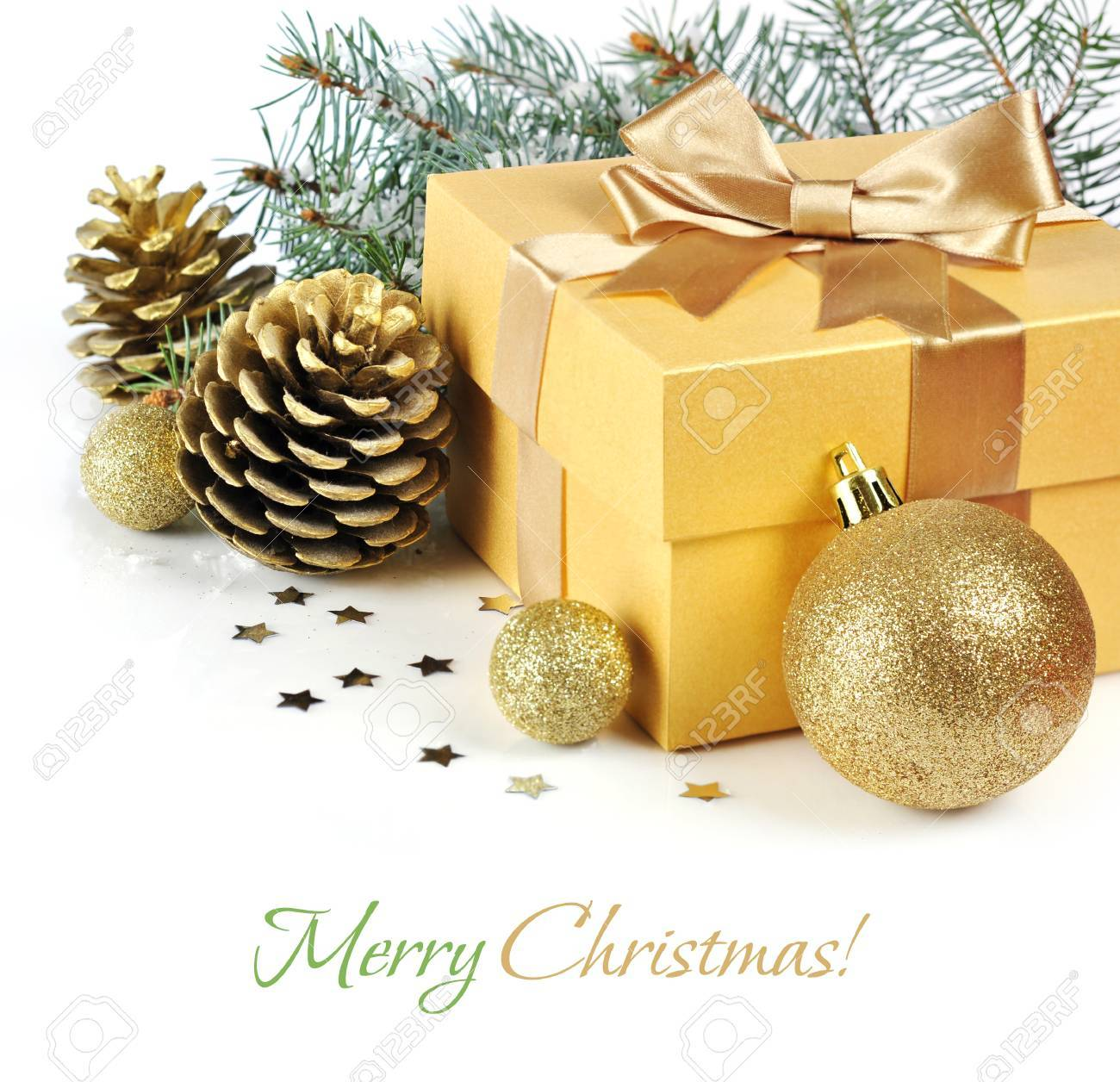 gold Christmas gift with balls and pinecones isolated on white background Stock Photo - 16602568