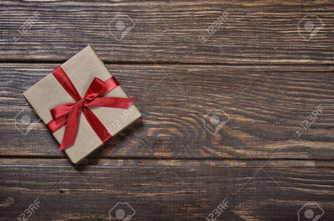 Gift box with red ribbon over wooden background Stock Photo - 17306534