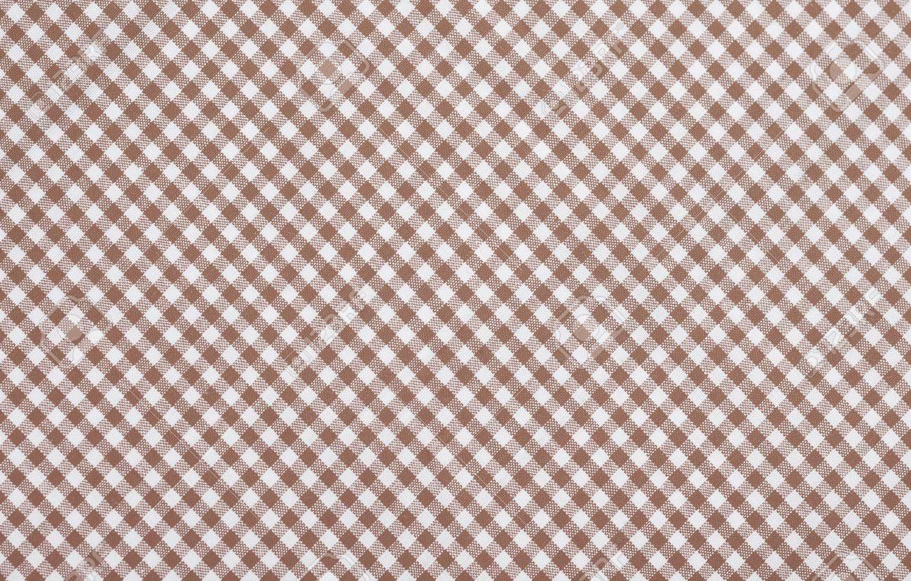 brown checkered fabric closeup , tablecloth texture Stock Photo - 18409535
