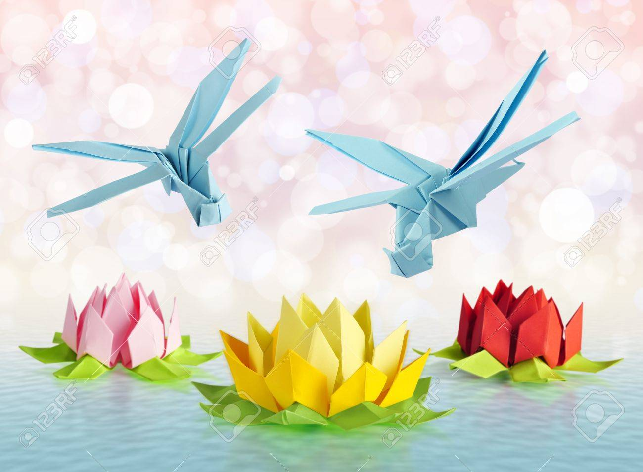 origami blue dragonfly over flowers lotus over white background Stock Photo - 18549151