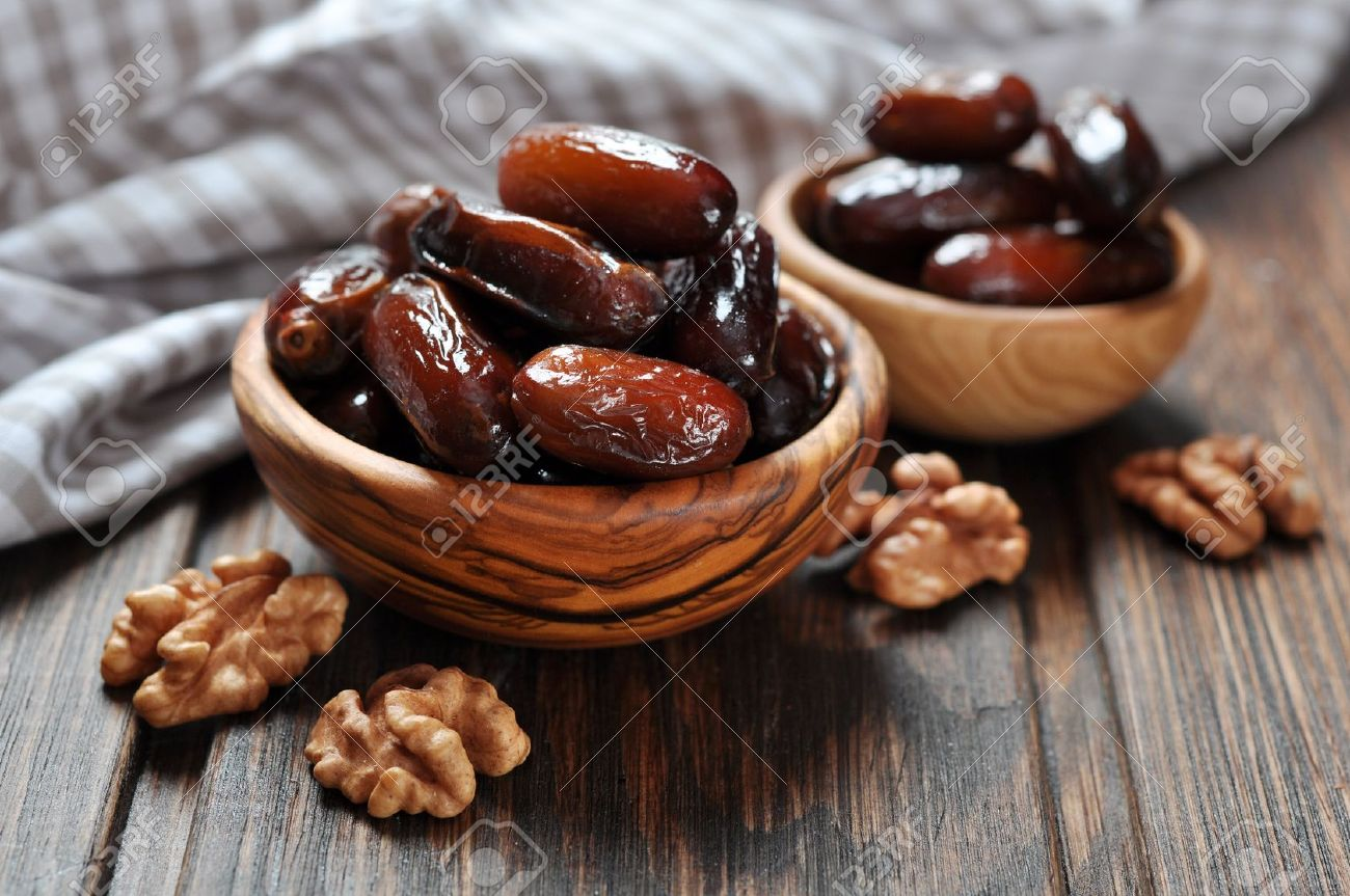 Dates fruit in a wooden bowl closeup on wooden background Stock Photo - 20363851