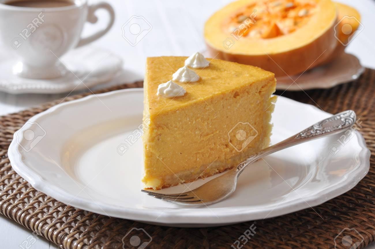 Fresh Homemade Pumpkin Pie with whipped cream on white plate closeup Stock Photo - 22430060