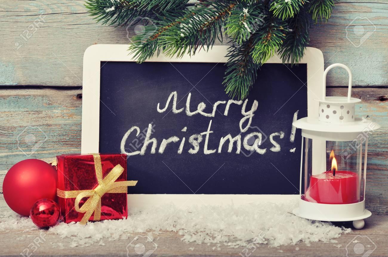 Decoración De La Navidad Con La Vela En La Linterna Y La Pizarra ...