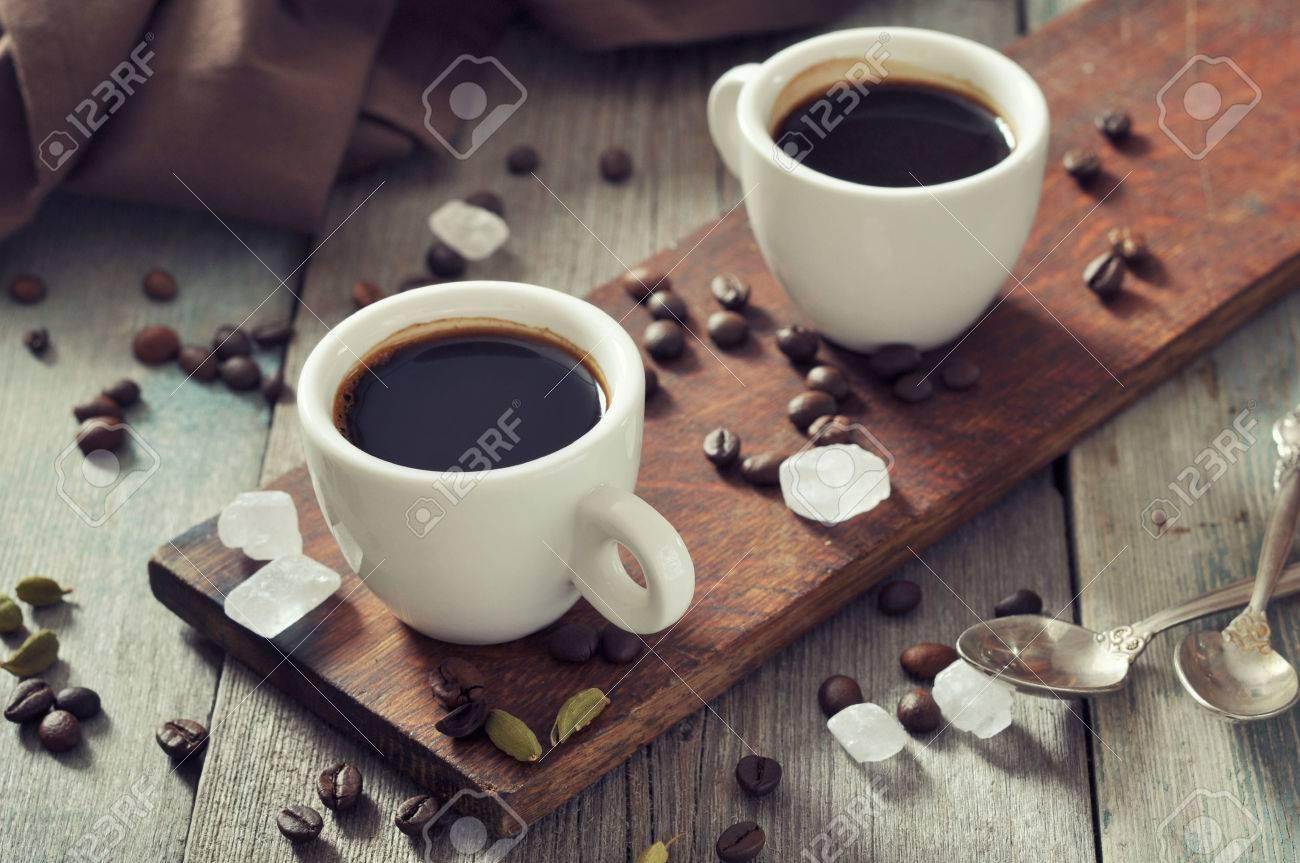 Coffee in cups with cardamom and white sugar on vintage wooden background Stock Photo - 23172717