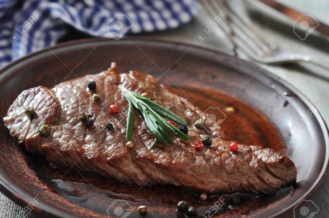 Grilled steak on plate with spices and rosemary closeup Stock Photo - 23949095