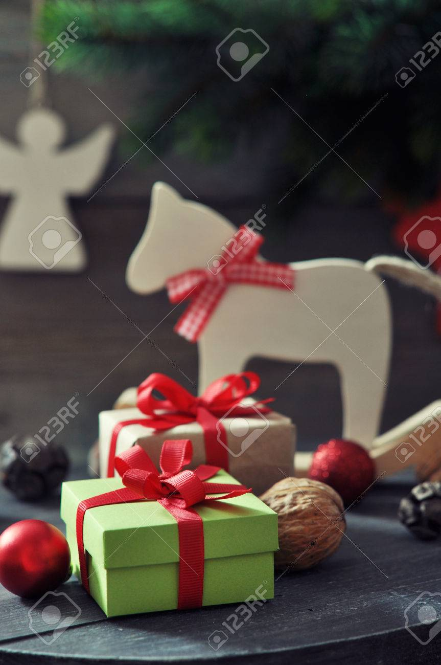 christmas decorations with gift boxes and horse toy on wooden stock photo 24148559