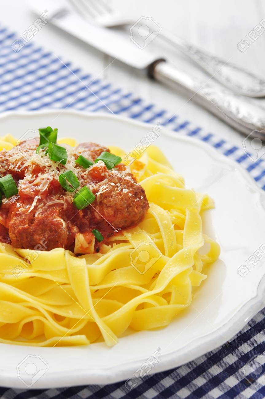 Meatballs with pasta and  parmesan in white plate on wooden background Stock Photo - 25819611