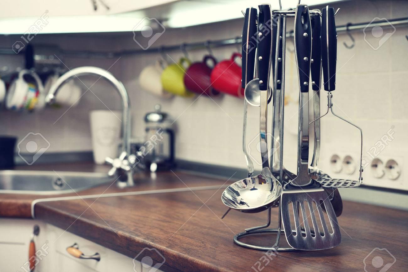 Modern Kitchen Utensils kitchen utensils on work top in modern kitchen stock photo