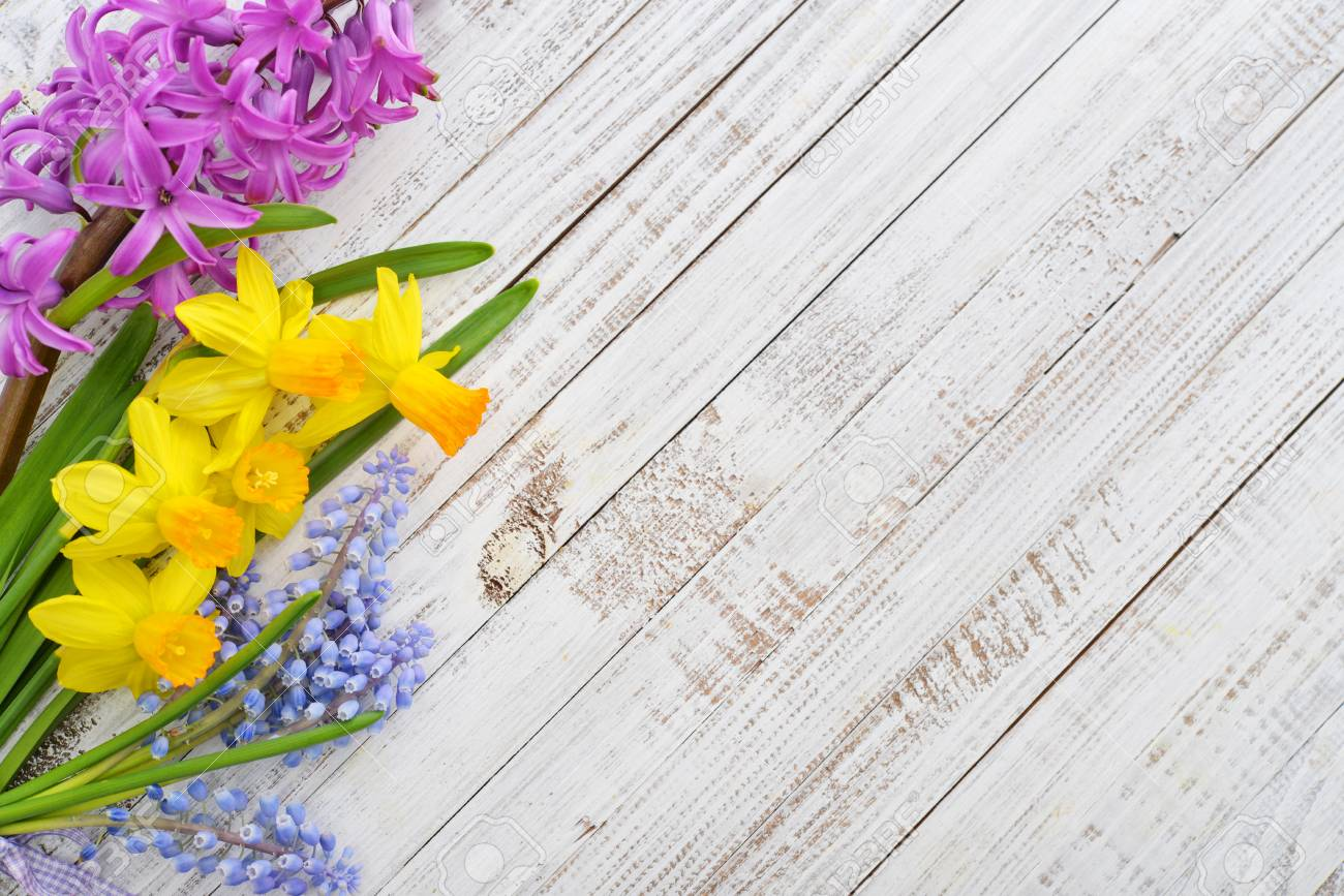 Spring Flowers Hyacinth And Narcissus On Wooden Background Stock
