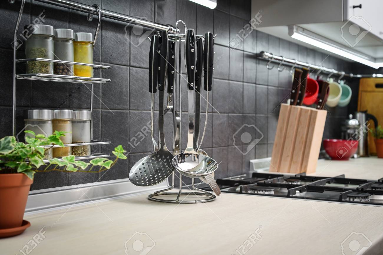 Kitchen Utensils On Work Top In Modern Kitchen Closeup Stock Photo